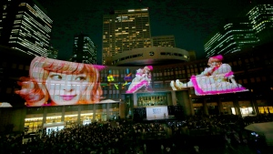 Images of Japanese fashion model and singer Kyary Pamyu Pamyu are projected on the Tokyo Metropolitan Government building during the Tokyo 2020 flag tour festival for the 2020 Games in Tokyo, Monday, July 24, 2017.  (AP Photo/Shizuo Kambayashi)