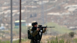 An Israeli soldier takes aim during clashes in the West Bank city of Ramallah, Monday, July 24, 2017. (AP / Nasser Shiyoukhi)