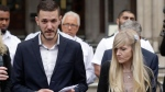 Chris Gard, the father of critically ill baby Charlie Gard finishes reading out a statement next to mother Connie Yates, right, at the end of their case at the High Court in London, Monday, July 24, 2017. (AP Photo/Matt Dunham)
