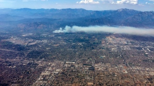 In this aerial photo, a wildfire burns in the San Bernardino National Forest in Highland, Calif., Sunday, July 23, 2017. (AP Photo/Justin Pritchard)