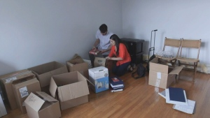 Chiara Norbitz and Mike Grubiak unpack after moving into new home.