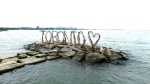 The new Toronto sign made out of driftwood and dry wall screws is seen. (CP24)