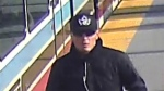 The suspect was wearing a dark ball cap, sunglasses, a black long sleeved top and blue jeans.