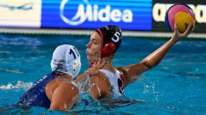 Monika Eggens, right, of Canada is challenged by Barbara Bujka of Hungary for the ball during the women's water polo quarterfinal match Hungary vs Canada at the 17th FINA Swimming World Championships in Hajos Alfred National Swimming Pool in Budapest, Hungary, Monday, July 24, 2017. (Balazs Czagany/MTI via AP)