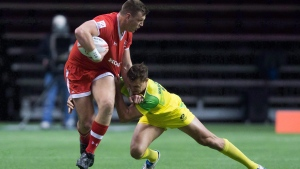 Canada's Adam Zaruba, left, fights off Australia's Stephan van der Walt during World Rugby Sevens Series' Canada Sevens tournament action in Vancouver on March 12, 2016. (Darryl Dyck/The Canadian Press)