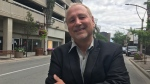 Larry Horwitz poses in front of the Pelissier Street parking garage on July 24, 2017 (Rich Garton / CTV News)