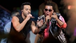 In this April 27, 2017 file photo, singers Luis Fonsi, left and Daddy Yankee perform during the Latin Billboard Awards in Coral Gables, Fla. (Lynne Sladky, File/AP Photo)