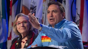 Indigenous and Northern Affairs Minister Carolyn Bennett looks on as Assembly of First Nations Chief Perry Bellegarde speaks during a session at the AFN Special Chiefs assembly in Gatineau, Wednesday, Dec. 7, 2016. (Adrian Wyld / THE CANADIAN PRESS)