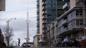The CN Tower can be seen behind condo's in Toronto's Liberty Village community on April 25, 2017. (Cole Burston / THE CANADIAN PRESS)