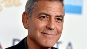 In this Saturday, Oct. 1, 2016, file photo, George Clooney arrives at MPTF's 95th Anniversary Celebration 'Hollywood's Night Under The Stars' in Los Angeles. (Photo by Jordan Strauss/Invision/AP, File)