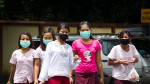 Women wear masks to protect themselves against the swine flue virus, Tuesday, July.25, 2017, in Yangon, Myanmar. (Thein Zaw/AP)