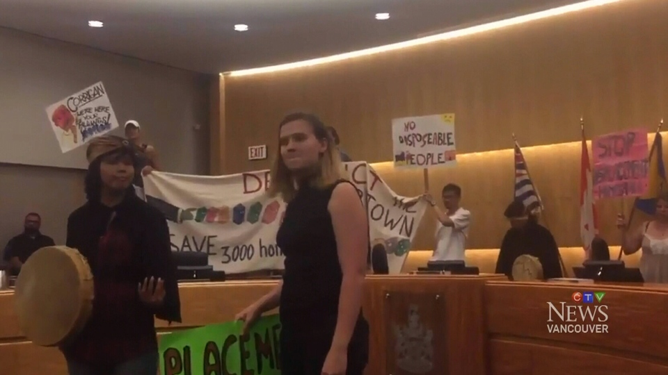 Affordable housing advocates are seen inside council chambers at a Burnaby council meeting on Monday, July 24, 2017. (@StopDisplacement / Twitter)