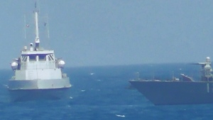 In this image provided by the U.S. Navy, USS Thunderbolt is seen near the Iranian vessel.