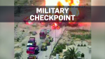 Tank runs over car bomb in attempt to stop blast