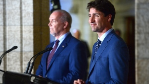 Prime Minister Justin Trudeau holds a press conference with Premier of British Columbia John Horgan following their meeting on Parliament Hill in Ottawa, on Tuesday, July 25, 2017. (THE CANADIAN PRESS/Sean Kilpatrick)