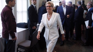 Ontario Premier Kathleen Wynne makes her way to the the Council of Federation meetings in Edmonton Alta, on Tuesday July 18, 2017. (THE CANADIAN PRESS/Jason Franson)
