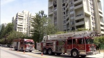 Firefighters respond to a blaze on the 10th floor of a highrise in Burnaby, B.C. July 12, 2017. (CTV)
