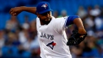 Toronto Blue Jays starting pitcher Cesar Valdez delivers a pitch against the Oakland Athletics during second inning American League MLB baseball action in Toronto on Tuesday, July 25, 2017. (Mark Blinch/The Canadian Press)