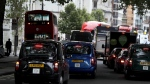 Vehicles drive in central London, on July 26, 2017. (Kirsty Wigglesworth / AP)