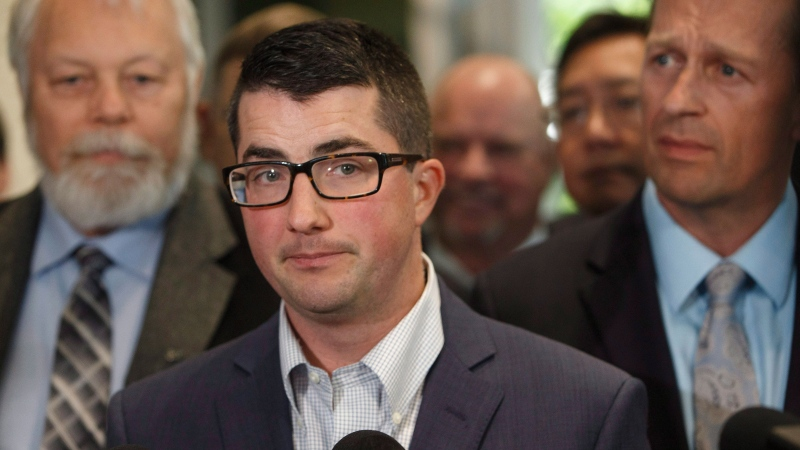 United Conservative Party interim leader Nathan Cooper speaks to media after the first meeting the new United Conservative Party caucus in Edmonton Alta, on Monday July 24, 2017. THE CANADIAN PRESS/Jason Franson
