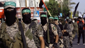 Masked militants from the Izzedine al-Qassam Brigades, a military wing of Hamas, march with their rifles during a parade against Israeli arrangements in a contested Jerusalem shrine, along the streets of Gaza City, Tuesday, July 25, 2017. Muslim leaders urged the faithful Tuesday to keep up their prayer protests and avoid entering a contested Jerusalem shrine, even after Israel dismantled metal detectors that initially triggered the tensions. (AP Photo/Adel Hana)
