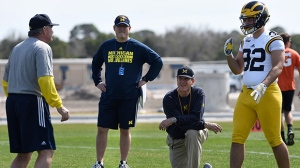 In this Feb. 29, 2016, file photo, Michigan's head coach Jim Harbaugh, center right, watches defensive coordinator Don Brown, left, work with Cheyenn Robertson during NCAA college football practice in Bradenton, Fla.(Tiffany Tompkins/The Bradenton Herald via AP, File)