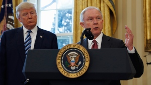 U.S. President Donald Trump listens as Attorney General Jeff Sessions speaks in the Oval Office of the White House in Washington, Feb. 9, 2017, after Vice President Mike Pence administered the oath of office to Sessions. (AP / Pablo Martinez Monsivais)