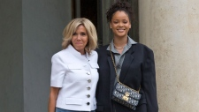 Brigitte Macron, left, the wife of French President Emmanuel Macron welcomes Singer Rihanna at the Elysee Palace to meet French President Emmanuel Macron in Paris, France, Wednesday, July 26, 2017. Global Ambassador for the Global Partnership for Education Rihanna meet French President Emmanuel Macron to discuss France's contributions to the Global Partnership for Education. (Michel Euler / AP)
