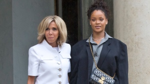 Brigitte Macron, left, the wife of French President Emmanuel Macron welcomes Singer Rihanna at the Elysee Palace to meet French President Emmanuel Macron in Paris, France, Wednesday, July 26, 2017. (AP Photo/Michel Euler)
