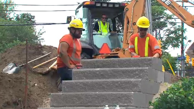 City crews are seen building a new set of stairs at an Etobicoke park.