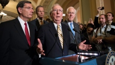 Senate Majority Leader Mitch McConnell of Ky., joined by, from left, Sen. John Barrasso, R-Wyo., Sen. John Thune, R-S.D., and Senate Majority Whip John Cornyn of Texas, speaks with reporters on Capitol Hill in Washington, Tuesday, July 25, 2017. (AP Photo/J. Scott Applewhite)