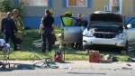 Emergency crews attend to the occupant of a stolen Lexus RX330 following a Wednesday morning crash in Forest Lawn