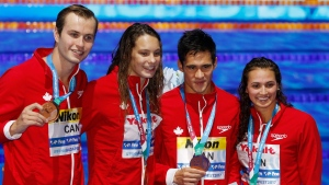 Canada's Yuri Kisil, Penny Oleksiak, Richard Funk and Kylie Jacqueline Masse, from left, show off their bronze medal for the mixed medley relay event during the swimming competitions of the World Aquatics Championships in Budapest, Hungary, Wednesday, July 26, 2017. (AP Photo / Darko Bandic)