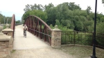 A cyclist rides the bridge over Laurel Creek in Waterloo Park on Wednesday, July 26, 2017. (Kevin Doerr / CTV Kitchener)