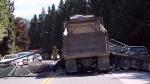 A dump truck hit a pedestrian overpass in Burnaby on Wednesday, July 26, 2017.