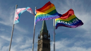 The pride and transgender flags fly on Parliament Hill following a ceremony with Prime Minister Justin Trudeau in Ottawa, Wednesday June 14, 2017. THE CANADIAN PRESS/Adrian Wyld