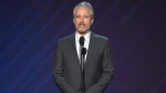 FILE- In this July 12, 2017, file photo, Jon Stewart presents the Pat Tillman award for service at the ESPYS at the Microsoft Theater in Los Angeles. HBO announced Wednesday, July 26, that Stewart will return to the network for his first stand-up special since 1996. (Photo by Chris Pizzello/Invision/AP, File)