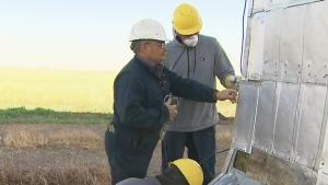 Man preserving grain elevators in Manitoba