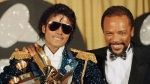 FILE - In this Feb. 28, 1984 file photo, Michael Jackson, left, holds eight awards as he poses with Quincy Jones at the Grammy Awards in Los Angeles. (AP Photo/Doug Pizac, File)