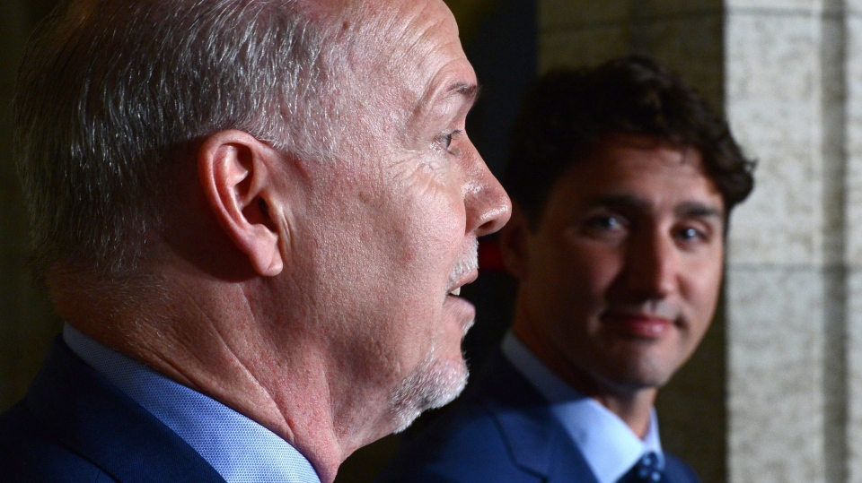 Prime Minister Justin Trudeau holds a press conference with Premier of British Columbia John Horgan following their meeting on Parliament Hill in Ottawa on Tuesday, July 25, 2017. (THE CANADIAN PRESS/Sean Kilpatrick)