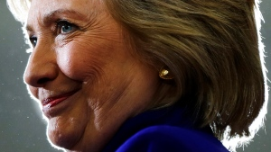 In this Sept. 21, 2016, file photo, Democratic presidential candidate Hillary Clinton pauses as she speak during a campaign stop at the Frontline Outreach Center in Orlando, Fla. (AP Photo/Matt Rourke, File)