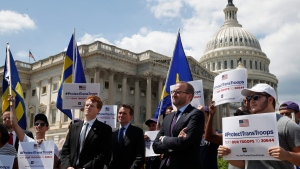 "Rep. Joe Kennedy, D-Mass., third from right, listens during an event in support of transgender members of the military, Wednesday, July 26, 2017, on Capitol Hill in Washington, after President Donald Trump said he wants transgender people barred from serving in the U.S. military ""in any capacity,"" citing ""tremendous medical costs and disruption."" (AP Photo/Jacquelyn Martin)"