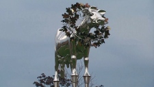 A chrome statue of the prize-winning Holstein cow 'Brookview Tony Charity' is shown in Markham, Ont.