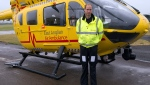 This is a Monday July 13, 2015 file photo of Prince William, as he poses in front of an East Anglian Air Ambulance (EAAA) as he begins his new role, at Cambridge Airport, Cambridge, in England. (Stefan Rousseau, Pool, File via AP)