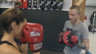 Joshua Harley, right, teaches Muay Thai and self-defence at his gym near the Lachine Canal