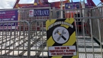 Fencing and signage is seen outside the Fire Ball ride at K-Days Thursday, July 27, after a fatal incident at a similar ride at the Ohio State Fair Wednesday.