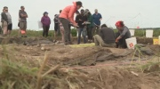 Archaeology university students dig up human remains from another century in New Brunswick.