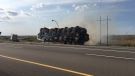 Hay bales burn on a semi-trailer on Highway 1 just east of Moose Jaw on Thursday, July 27, 2017. (ROBERT SAGAL / SUBMITTED)