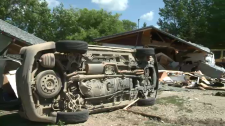 Bulldozer plows through house; charges laid