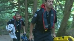 Woman rescued from remote swimming hole
